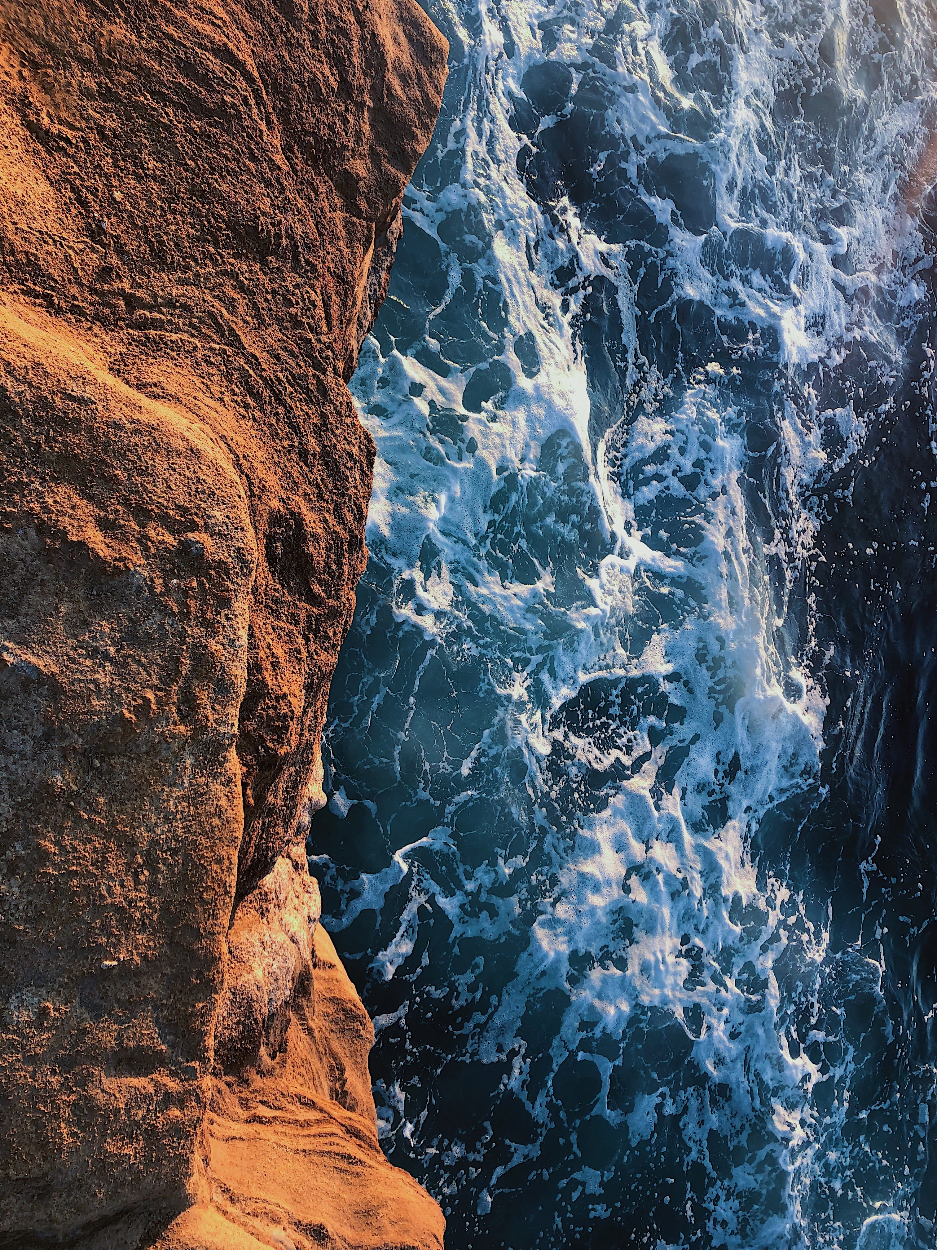 A photo of churning ocean water beneath Sunset Cliffs in San Diego. Credit: Leila Bandringa